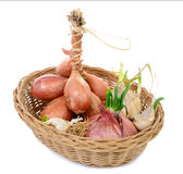 Shallots and onions in a basket Stock Photography