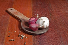 Shallots. Placed on wooden spoon Royalty Free Stock Photos