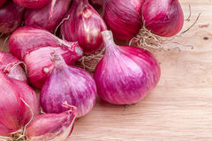 Shallots on wooden background Stock Photo