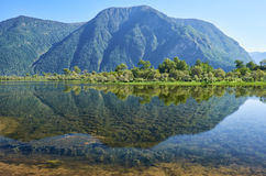 Shallow bay on South part of Lake Teletskoye  in Altay Royalty Free Stock Photo
