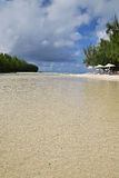 The shallow beach water area between Ile aux Cerfs and Ilot Mangenie royalty free stock image