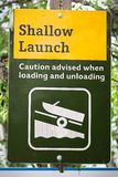 A shallow boat launch sign advising caution.  royalty free stock image