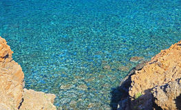 Shallow clear sea of Crete Stock Images