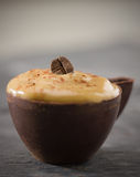 Shallow coffee mousse in a dark chocolate cup Royalty Free Stock Photography