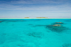 Shallow coral reef in turquoise transparent water, Aitutaki, Cook Islands royalty free stock photography