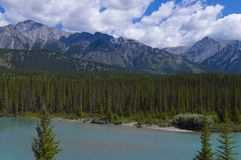 Shallow Crystal Blue Mountain River in Banff Stock Image