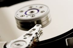 Shallow data. Close up of a hard drive(focus on pickup head royalty free stock photo