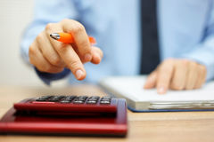 Shallow depth of field of accountant calculating financial data Stock Photos