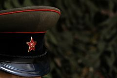 Shallow depth of field. A symbol of a Soviet soldier: a cap with a five-pointed star. Officer of the USSR during the Great Patriot