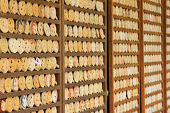 Shallow depth of field of mirror-shaped wooden preyer tablets in. Shallow depth of field of mirror-shaped wooden preyer tablets (called Kagami ema) in Kyoto Stock Photography