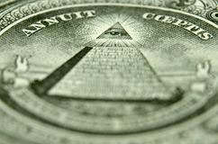 Shallow depth of field picture of the eye of providence on the back of an American single. royalty free stock image
