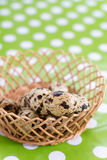 Shallow depth of field quail eggs in the basket Stock Images