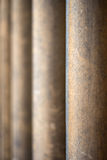 Shallow depth of field on receding worn stone pillars Stock Photo