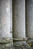 Shallow depth of field on receding worn stone pillars Stock Photos