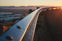 Sunrise behind highway rail Cape Town royalty free stock photos