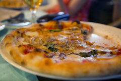 Shallow depth of field shot of a typical classic italian pizza Royalty Free Stock Photography
