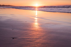 Shallow depth of field sunset with sea and beach Royalty Free Stock Photos