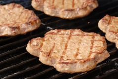 Shallow DOF of hamburgers on a barbecue Stock Image