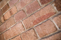 Shallow DOF perspective of weathered red bricks in Sydney Stock Images