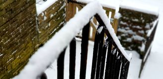 Shallow Focus of Black Stair Frames Covered in Snow Stock Images