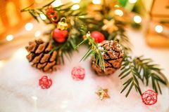 Shallow Focus Brown Pinecone Near Red and Black Ornament Royalty Free Stock Photography