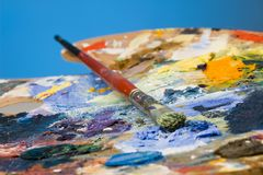 An artists paint palette and brush royalty free stock image