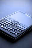 Shallow focus Macro of a Smart phone. With full keyboard. High tech blue tint royalty free stock images