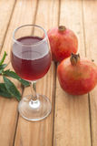 Shallow focus of organic Pomegranate Juice healthy drink. On wooden pallet royalty free stock photos