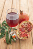 Shallow focus of organic Pomegranate Juice healthy drink. On wooden pallet stock images