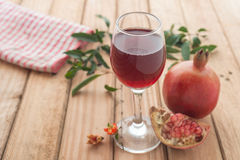 Shallow focus of organic Pomegranate Juice healthy drink. On wooden pallet background stock photo