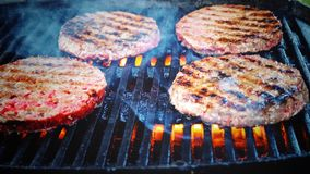 Shallow Focus Photo of Patties on Grill Stock Photo
