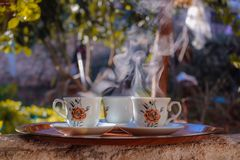 Shallow Focus Photo of Three White-brown-and-black Ceramic Floral Mugs on Saucers Stock Photos