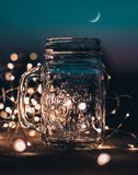 Shallow Focus Photograph of Clear Glass Mason Jar With Fairy Lights stock photography