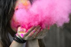 Shallow Focus Photograph of Woman Blowing Pink Powder Stock Photography