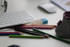 Shallow Focus Photography of Assorted Pencils Near Apple Keyboard and Mouse Stock Photo