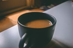 Shallow Focus Photography of Black Ceramic Mug Filled With Brown Coffee on the Table Stock Photography