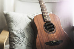 Shallow Focus Photography of Brown Acoustic Guitar on White and Black Leaf Print Pillow Royalty Free Stock Photos