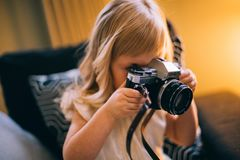 Shallow Focus Photography of Girl Holding a Black and Silver Dslr Camera Stock Photography