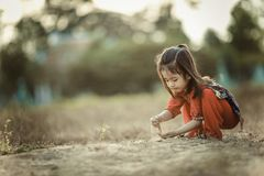 Shallow Focus Photography of Girl in Orange Pants Holding Brown Soil Royalty Free Stock Image