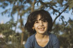 Shallow Focus Photography of Girl Wearing Blue Shirt royalty free stock photography