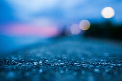 Shallow Focus Photography of Gray Asphalt Floor Stock Photo
