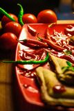 Shallow Focus Photography of Green and Red Chili on Plate stock photo