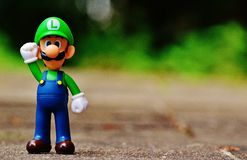 Shallow Focus Photography of Luigi Plastic Figure Royalty Free Stock Photos