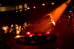 Shallow Focus Photography of Man in Black Fedora Hat With Red and Orange Spotlight Stock Photo