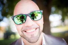 Shallow Focus Photography of Man in Gray Top Wearing Green Sunglasses With Black Frames Stock Image