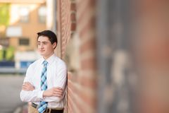 Shallow Focus Photography Of Man Leaning On Wall royalty free stock photos