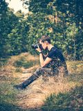 Shallow Focus Photography of Man Taking Photo in Forest