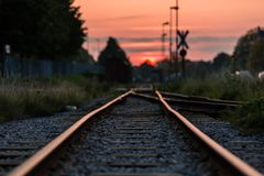 Shallow Focus Photography of Railway during Sunset Royalty Free Stock Image
