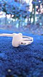 Shallow Focus Photography of White Samsung Earphones stock photo