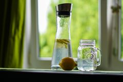 Shallow Focus Photography of Yellow Lemon Near Glass Mason Jar and Glass Decanter Stock Photos
